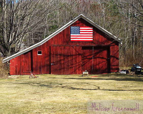 Red barn, flag, winter shadow, and red tricycle: classic NH.