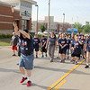 Michael Murphy carries the torch at the beginning of the 16th leg of the Special Olympic's Law Enforcement Torch Run started Wednesday morning in downtown Effingham. The event raises awareness and money for the Special Olympics. The state competitions begin on Friday. Graham Milldrum photo