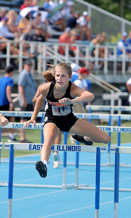 Altamont's Grace Nelson jumps over a hurdle during the 100-meter hurdle event at the Class 1A girls track and field state finals, on Thursday, July 10, 2021, at O'Brien Field on the campus of Eastern Illinois University in Charleston, Illinois.