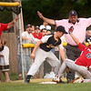 6-21-12<br /> Championship little league game between Lion's Club and McPike<br /> Jack Perkins of McPike is declared safe on third base before Luke Lushin of Lion's Club can get him out.<br /> <br /> KT photo | Kelly Lafferty
