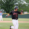 North Clay's Holden Clifton smiles after hitting a home run during a baseball game against Effingham (St. Anthony) in the Class 1A Sectional 6 Regional Finals on Monday, July 7, 2021, at Evergreen Hollow Park, in Effingham, Illinois. (Alex Wallner/Effingham Daily News)