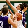 Windsor/Stew-Stras' Josh Overbeck, center, tries to get around the pick set by Arcola's Clayton Miller, right. Overbeck led the Hatchets in scoring with 14 points, but Miller had an even bigger night with 21 as Arcola handed the Hatchets their first loss of the season at 62-52.