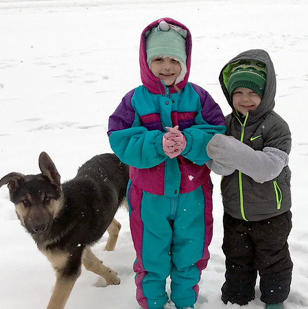 So much fun with grandma and grandpa's new puppy, Ozzie's first snow. Ella and Theo Schabbing of Teutopolis pictured.