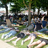 Demonstrators lie on their stomachs to observe nine minutes of silence in honor of George Floyd, who was killed by a Minnesota police officer in May.