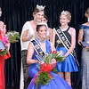 Retired 2019 Effingham County Fair Queen Shayna Phillips finishes crowning the 2020 queen Taylor Hartke as runners up Emily Becker, left, and Kyandra Zerrusen, far right, and 2020 Junior Miss Queen Joni Beckman, second to right, look on.