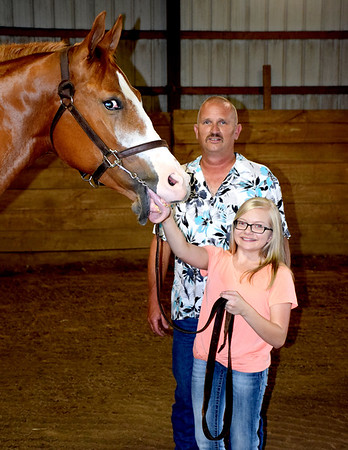 Legends Style, left, helped bring home three honors from the Pinto Horse World Show in Tulsa, Oklahoma. Dale Bushue, middle, placed in the top 10 for both the Amateur and Open Halter Gelding divisions, Makenzie Bushue, right, placed second as Reserve World Champion in the Youth 3 and 4-year-old Halter Gelding class. Charles Mills photo