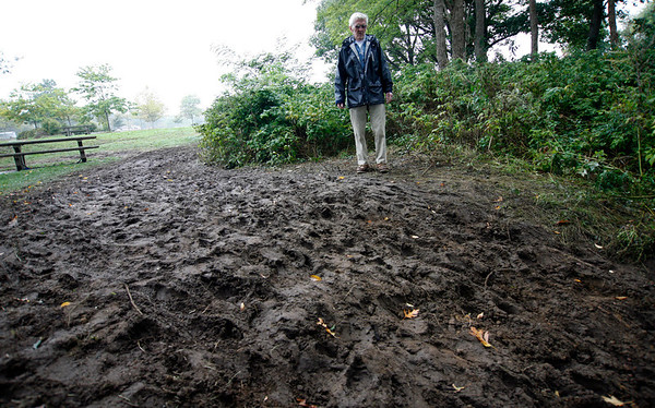 Allegra Boverman/Gloucester Daily Times. David Dow, a concerned Gloucester resident and frequent visitor to Stage Fort Park in Gloucester, is very concerned about the damage to the park done during the weekend's Annual Gran Prix of Gloucester Cyclocross Race.
