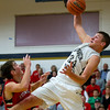 Teutopolis' Mitch Hardiek grabs a rebound over Effingham's Brent Beals. The Shoes' ability to outrebound the Hearts 26-17 played a big factor in their 83-74 win.