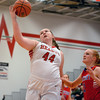 Effingham's Shelby Myers reaches up to grab a pass over the defense of St. Anthony's Abbie Schmidt during a game at Effingham High School.