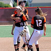 Illini Bluff's Addison Welsh receives a hug from a teammate after turning a double play during a softball game against Illini Bluffs in the Class 1A state championship game, Wednesday, June 16, 2021, at the Louisville Slugger Sports Complex in Peoria, Ill.