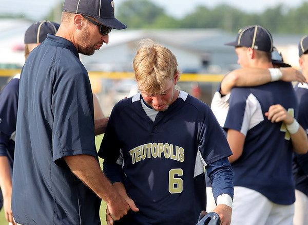 Teutopolis' Evan Addis walks off the field after losing to Columbia in the Class 2A Sectional Semifinals on Wednesday, July 9, 2021, at Teutopolis High School, in Teutopolis, Illinois. (Alex Wallner/Effingham Daily News)