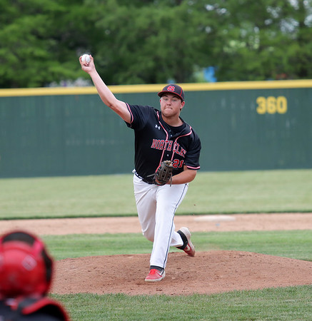 North Clay's Carson Burkett (21) throws a pitch during a baseball game against Effingham (St. Anthony) in the Class 1A Sectional 6 Regional Finals on Monday, July 7, 2021, at Evergreen Hollow Park, in Effingham, Illinois. (Alex Wallner/Effingham Daily News)