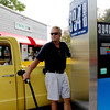 Allegra Boverman/Gloucester Daily Times. Nick Benn of Rockport gives his opinion about the current prices of gasoline at the Twin Stop Gulf gas station on Eastern Avenue in Gloucester on Friday.