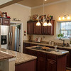 Granite countertops and stainless steel appliances give a contemporary feel to the Jobe kitchen.