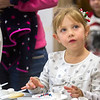 Five-year-old Maggie Shepard finishes her cookie decorating Saturday in the County Office Building as part of the annual Hometown Christmas which was sponsored by the Downtown Effingham Business Group and Effingham County Chamber of Commerce.<br /> Keith Stewart Photo