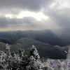 One of the many reasons I climb mountains...in any season!<br /> <br /> The view from North Twin. The Franconia Ridge is bathed in sunshine, and the low hump at the center of the photo is Mount Galehead, one of the more modest NH 4,000-footers. If you follow the ridge from Galehead's summit, you can just make out a white dot in the saddle below the summit; that's Galehead Hut.<br /> <br /> The sunrays are simply a really awesome bonus.