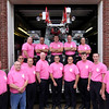 Allegra Boverman/Gloucester Daily Times. Members of Gloucester Fire Department's Group 4 team wearing the department's breast cancer awareness t-shirts at the Central Station on Wednesday. They are wearing the shirts during October, which is breast cancer awareness month, and selling the shirts at the station for $15.