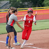 St. Anthony's Stacie Vonderheide high-fives head coach Makayla Walsh after a home run in the Class 1A Sectional Semifinals against Hutsonville on Tuesday, July 8, 2021, at St. Anthony High School, in Effingham, Illinois. (Alex Wallner/Effingham Daily News)