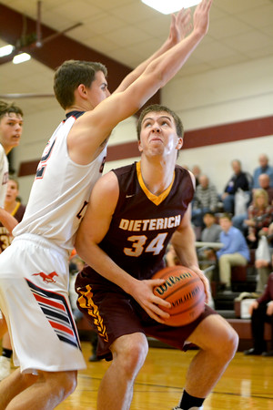 Dieterich's Tyler Higgs makes a move in the post against Centralia Christ Our Rock Lutheran at the Dieterich Holiday Tournament.