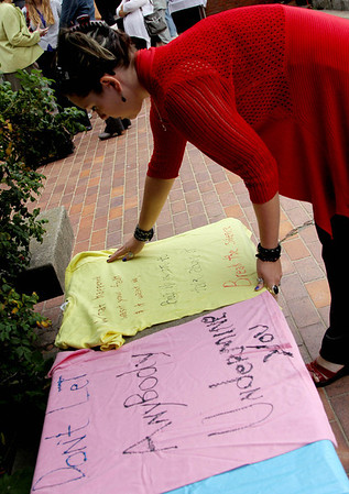 Allegra Boverman/Gloucester Daily Times. During the outdoor domestic violence awareness and recommitment ceremony held at the Gloucester Police Station on Tuesday to commemorate October as Domestic Violence Awareness Month and The Clothesline Project. Shain Doberman, the education, outreach and volunteer coordinator for North Shore Rape Crisis Center, set up an area where people could make their own t-shirts to put on display about the topic of domestic violence. A few people made shirts during the event.