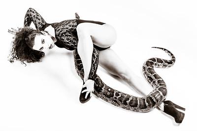 Model posing with python snake.