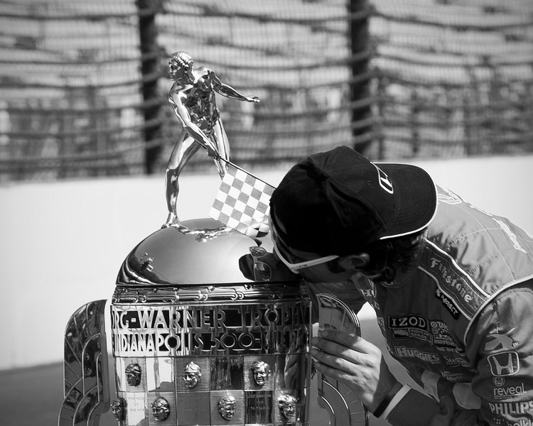 Dario Franchitti kissing the Borg Warner trophy after winning the Indianapolis 500...