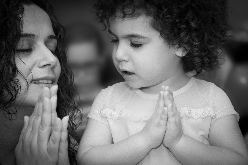 Mother and daughter making a wish (photo in black and white)