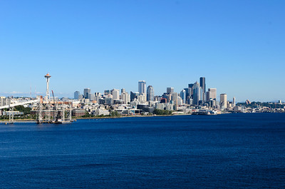 The city of Seattle, WA as viewed from the Serenity deck on board the Carnival Spirit docked at Pier 91, preparing to sail away.