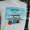 "Ripcurl t-shirt in a shop in Hua Hin, Thailand in August 2017. Painting of a tuk tuk with surfboards and the slogan ""live the search"""