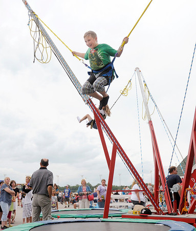"""Don Knight/The Herald Bulletin<br /> Rylan Louden, 11, jumps on a trampoline as Hoosier Park Racing and Casino hosted their """"Fire it Up on the 4th"""" Independence Day celebration on Thursday."""
