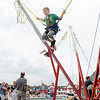 "Don Knight/The Herald Bulletin<br /> Rylan Louden, 11, jumps on a trampoline as Hoosier Park Racing and Casino hosted their ""Fire it Up on the 4th"" Independence Day celebration on Thursday."