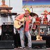 Don Knight/The Herald Bulletin<br /> Steve Tolliver sings lead vocals for the Trop Rock Junkies during their concert at Hoosier Park Racing and Casino on Thursday.