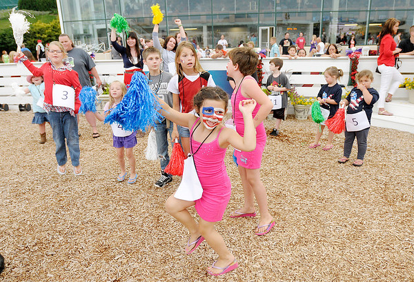 "Don Knight/The Herald Bulletin<br /> Kids cheer on their horse and driver during a contest to see who could cheer the loudest as Hoosier Park Racing and Casino hosted their ""Fire it Up on the 4th"" Independence Day celebration on Thursday."