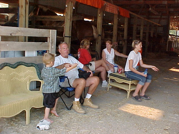 Dad and the Grandkids resting <br /> Working these horses is hard work