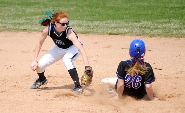 Don Knight | The Herald Bulletin<br /> Jennings County's Mackenzie Byram beats the tag of Pendleton Heights' Sarah Dixon during the Horseshoe Classic softball tournament on Saturday.