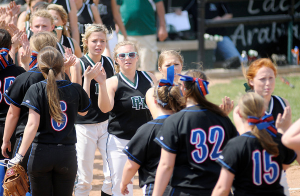 Don Knight | The Herald Bulletin<br /> Pendleton Heights and Jennings County meet at home plate and touch hands after meeting in the semi-final of the Horseshoe Classic softball tournament on Saturday.