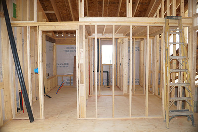 Looking from master bedroom into bath and walk in closet area.