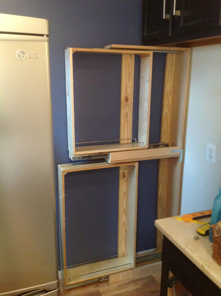 We ordered a tall, 6 inch pull out cabinet and then ordered custom doors to paint for a pantry right by the fridge