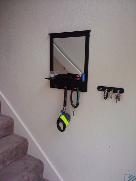Added a mirror/shelf unit to the front door entryway.