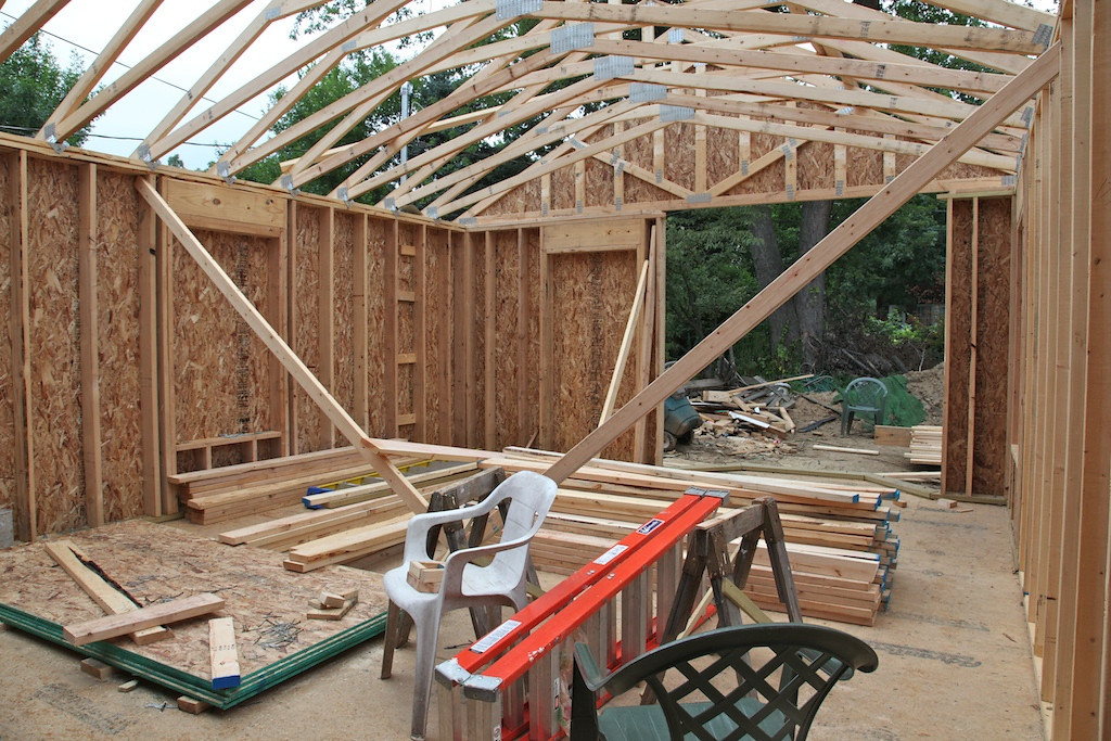 Aug 1 - more trusses up and this is the family room looking out from the kitchen.