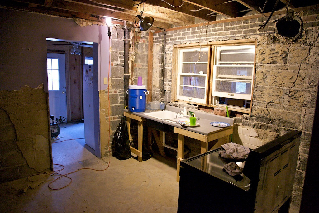 Sept 3 - our kitchen with the hacked together sink and stove... nothing but walls