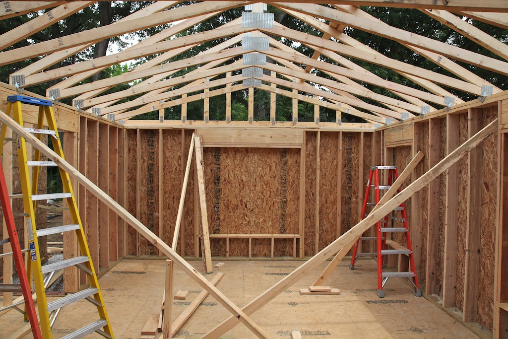 July 30 - trusses are up! This is the master bedroom looking out from where my old office was - which will become the master bath.