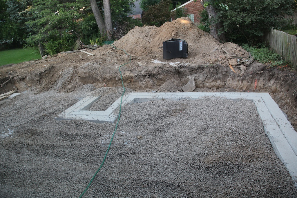 June 30 The foundation footings are in place and they've filled in the gravel for the floor of the crawlspace