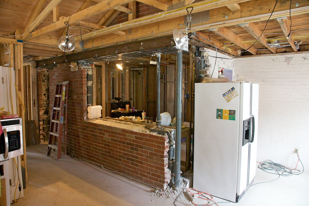 Oct 3 - finally have the steel in place over the kitchen (holding up the upper floor bricks etc) and we're now opening up the wall!