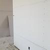Living room / 2nd bath wall