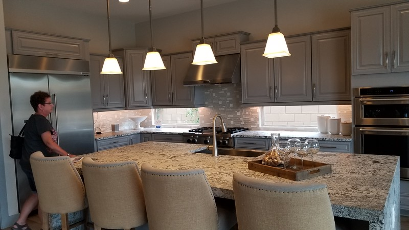 4 seat island, painted cabinets, textured granite counter, single sink farmer