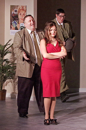 Mark Maynard | For The Herald Bulletin<br /> Walking in on a conversation between company president J. B. Biggley (Tony Johnson) and newly hired secretary Hedy LaRue (Julianne Boyd), Bud Frump (Martin Stapleton) discovers that they are having a secret affair.