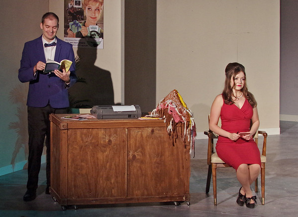 """Mark Maynard   For The Herald Bulletin<br /> Using the instructions in his copy of """"How to Succeed in Business Without Really Trying,"""" J. Pierrepont Finch (Joshua Wilkinson) easily discovers that Hedy LaRue (Julianne Boyd) has no secretrial skills whatsoever."""