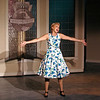 "Mark Maynard | For The Herald Bulletin<br /> Rosemary Pilkington (Kayla Shoemaker) dreams of life in the suburbs as Mrs. J. Pierrepont Finch as she sings ""Happy to Keep His Dinner Warm"" in ""How to Succeed in Business Without Really Trying"" at Anderson's Mainstage Theatre."
