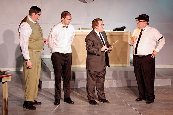 Mark Maynard | For The Herald Bulletin<br /> Bud Frump (Martin Stapleton) and J. Pierrepont Finch (Joshua Wilkinson) wait nervously as personnel manager Bert O. Bratt  (Cameron Vale) and Mr. Twimble (Scott McFadden), decide which of them will be named the new head of the mailroom.